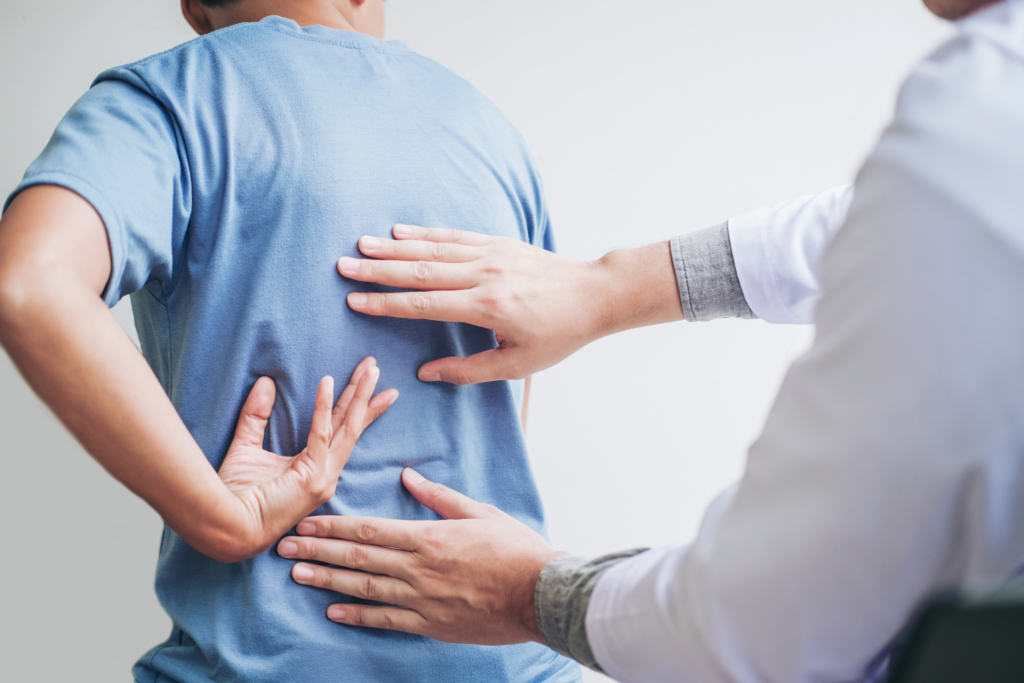 Living Well Family Medicine of Boerne Doctor consulting with patient Back problems Physical therapy concept