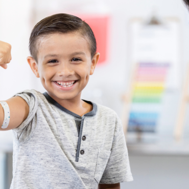 Living Well Family Medicine of Boerne little boy shows off arm bandage at pediatrician