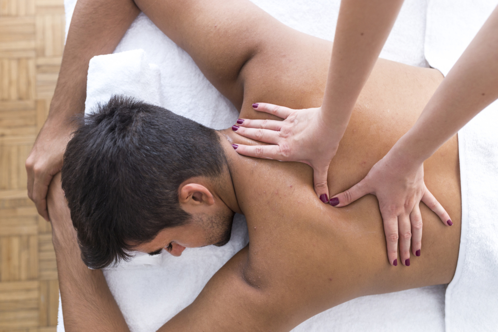 living well boerne family medicine Young man is enjoying massage on spa treatment