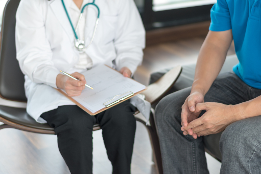 living well boerne family medicine Urologist Doctor giving consult for prostate problems to patient. Urologic oncologists specialize in treating cancer of the urinary tract and male reproductive organs. Mens health problem concept.